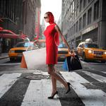 In red with bags in hands, girl