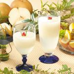 Pears, glasses, fruits, candles, juice