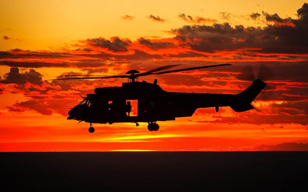 Helicopter sky sunset