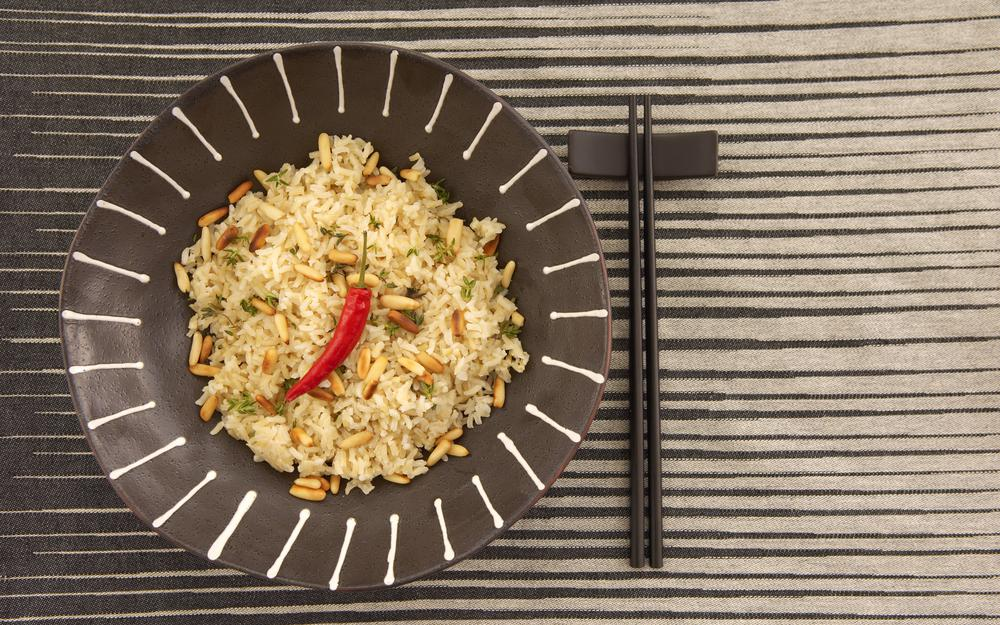 Plate, rice, table, pen, sticks