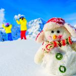 Snowman, people, mountains
