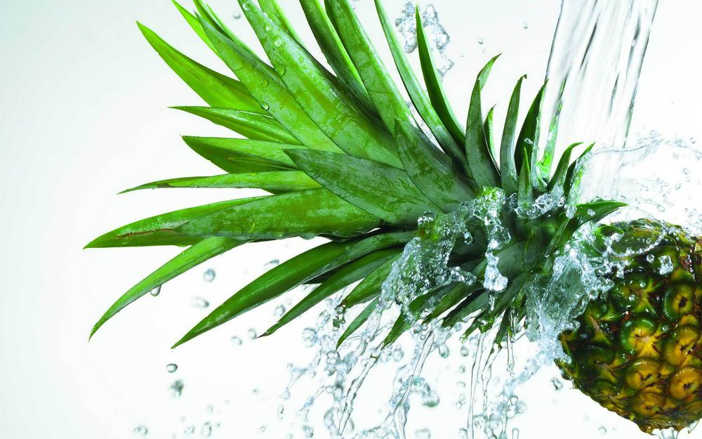 Pineapple under the jet of water