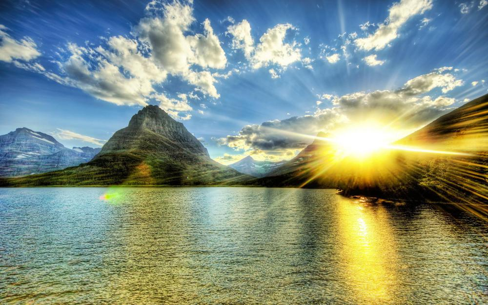 Bright sunrise because of the mountains hd wallpaper