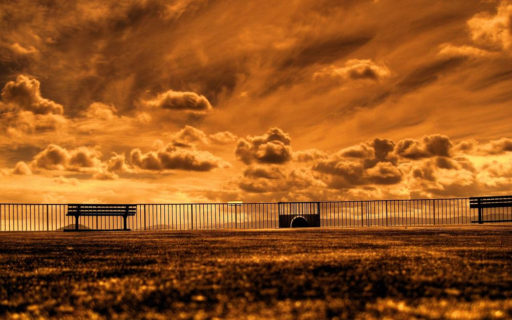 Railing, playground, sky, benches, clouds