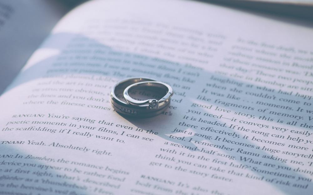 Book, rings, couple, engagement rings