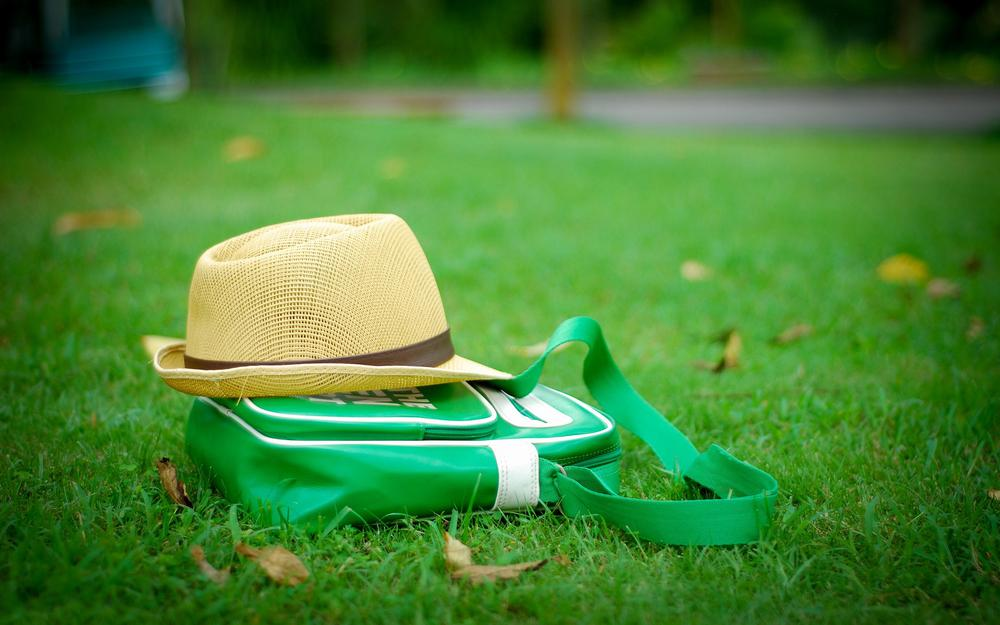 Hat with bag on the lawn