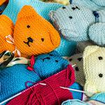 Knitting needles, toy, knitted