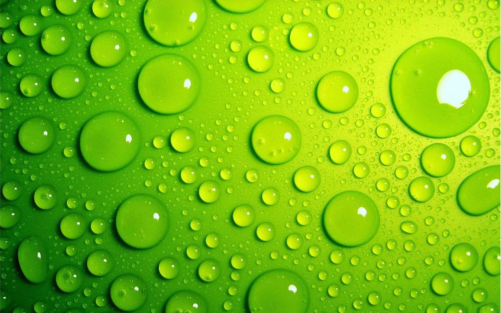 Round drops on green background