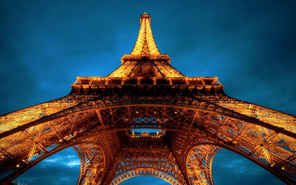 Eiffel tower paris in the lights at night
