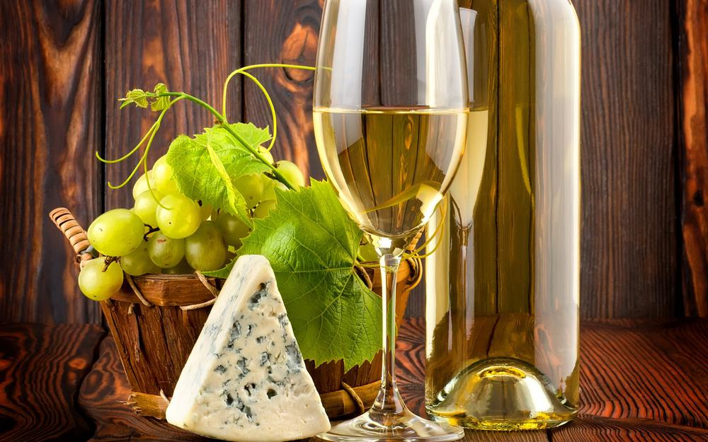 Wine, grapes, basket, cheese with mold