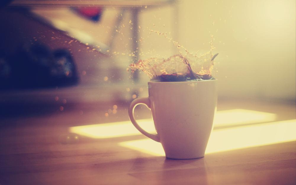 Coffee splashes in a cup