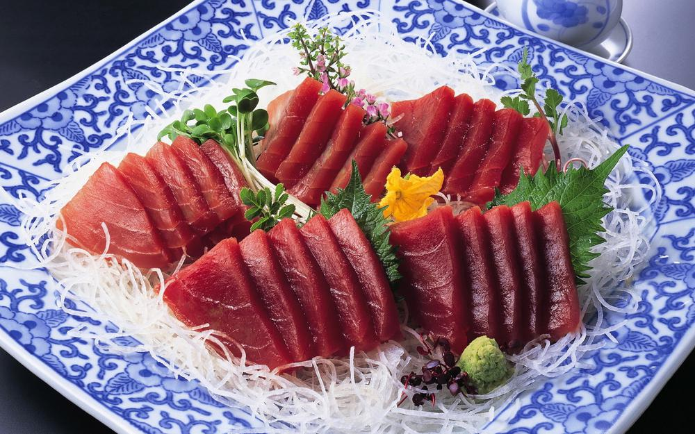 Red pieces of fish wallpaper