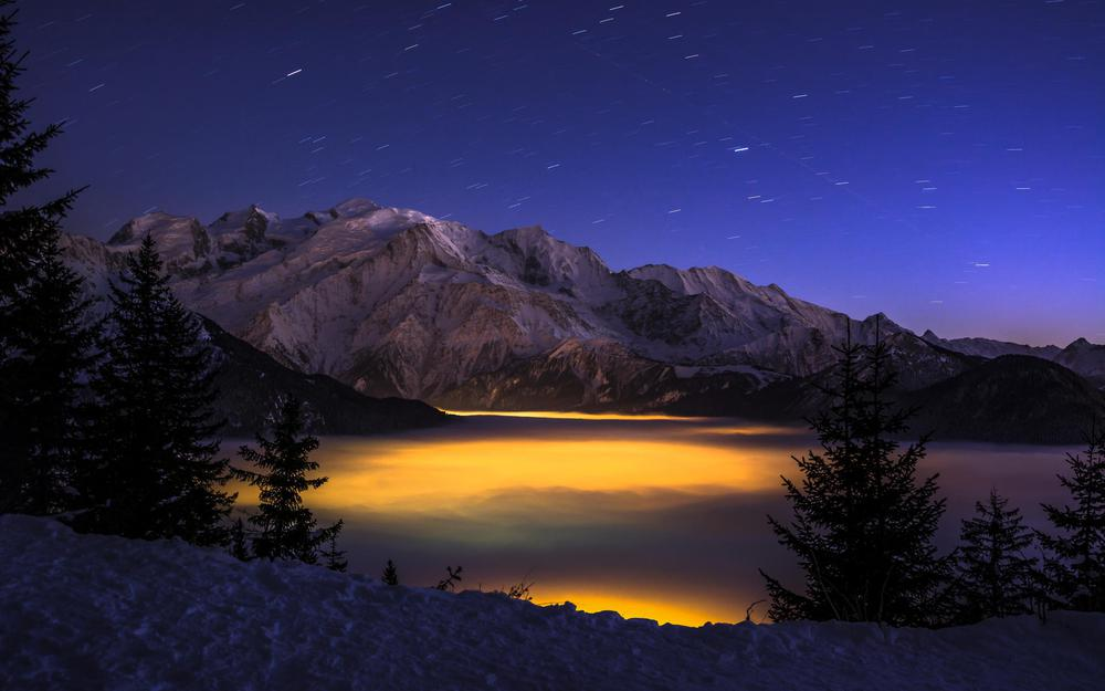 Night, gorge, lights, height, forest, mountains, clouds, winter